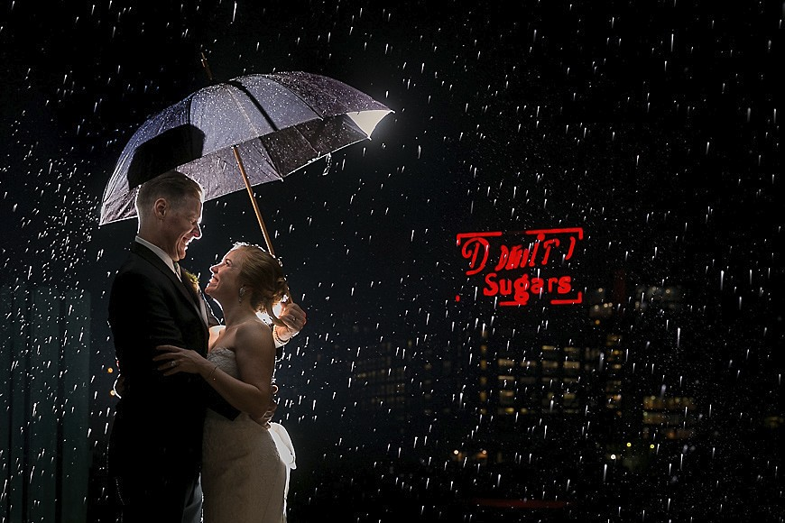Bride and groom posed in front of the Domino Sugar sign after their wedding in Baltimore Maryland