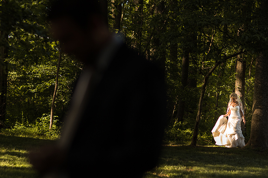 Bride walking to groom outside as she is highlighed by natural light at sunset during a Maryland wedding