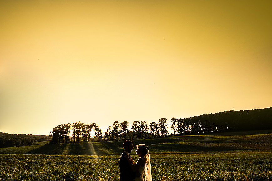 Wedding portrait under beautiful natural light as the sun sets across a field in Monkton Maryland
