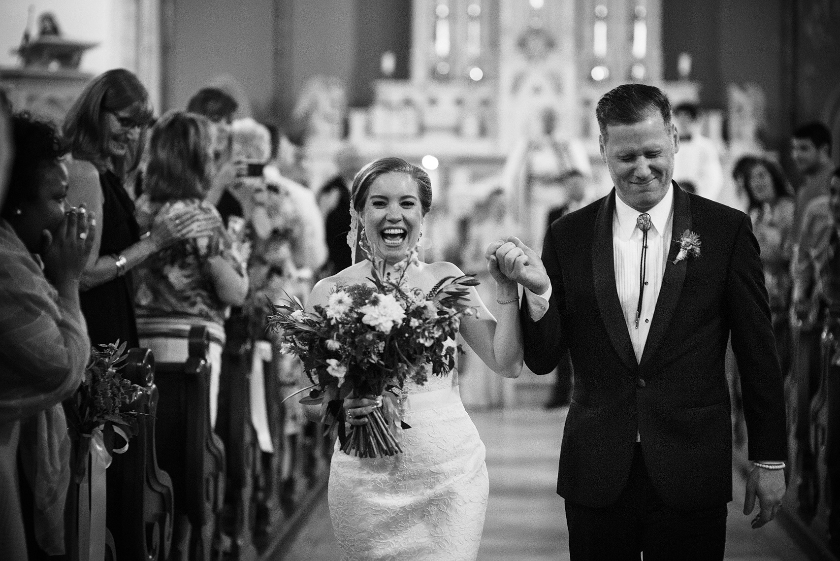 Wedding couple smiling as they exit their ceremony in Baltimore, Maryland