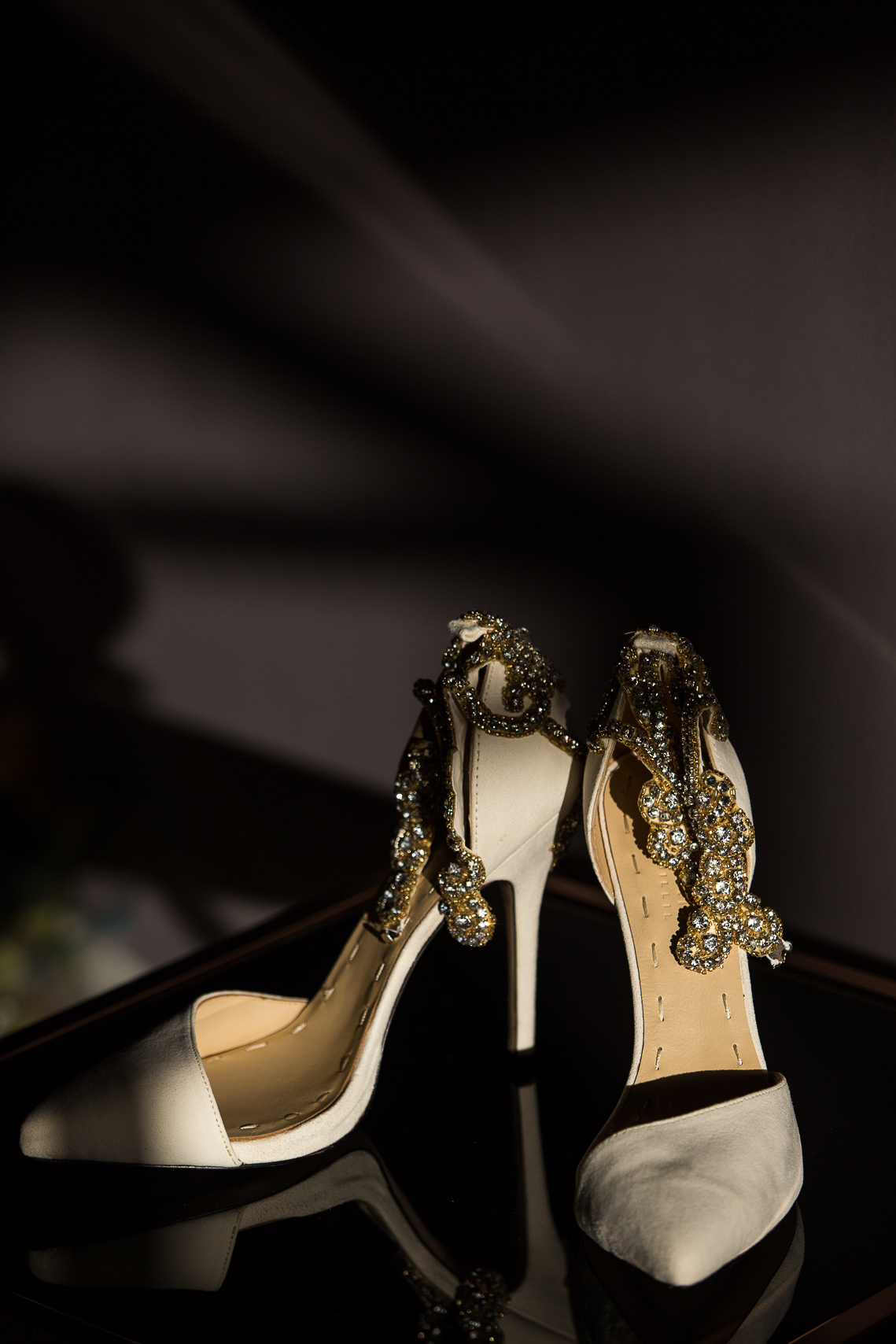 Wedding shoes with natural light and shadows