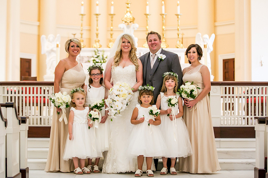 Wedding formal in the beautiful light of the Baltimore Basilica with flower girls holding white bouquets