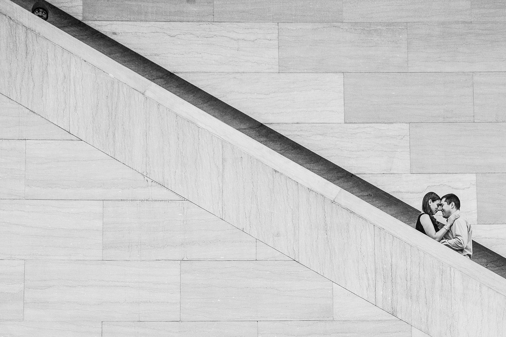 Couple on the steps outside the National Gallery of Art in Washington DC