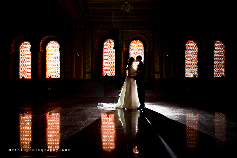 Bride and groom kissing in front of window at the Baltimore Grand Historic Venue