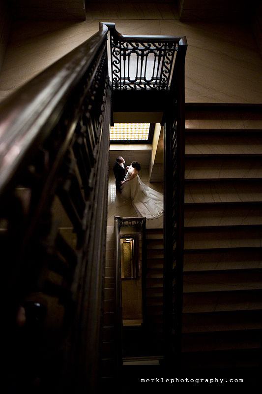 Wedding couple in the stairway of the historic Baltimore Grand Venue, formerly known as the Tremont Grand