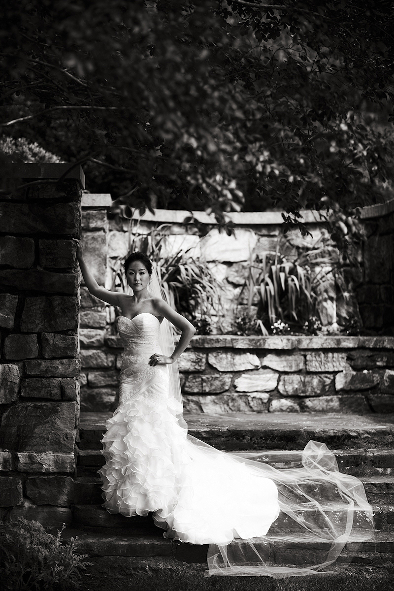 Bride posing against a wall before her Strong Mansion wedding
