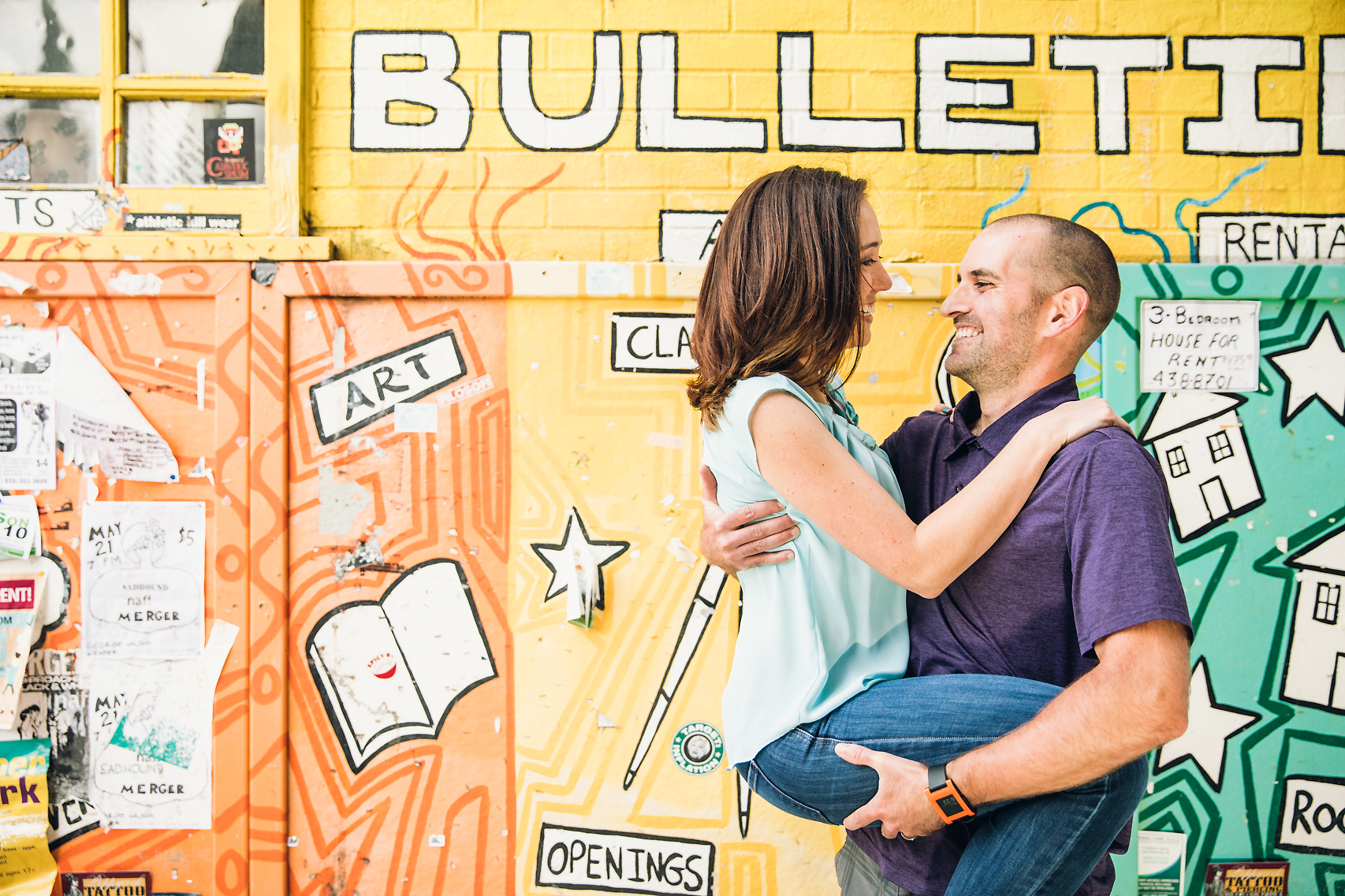 Engagement session in front of a bright painted wall at the University of Delaware