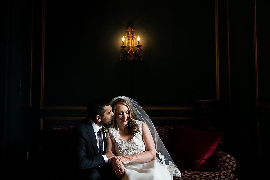 Bride and groom in an embrace in an elegant location at the Belvedere Hotel in Baltimore