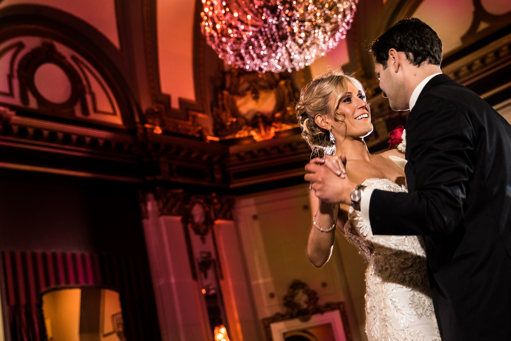 Bride and groom during their first dance in a grand ballroom at the Belvedere Hotel in Baltimore