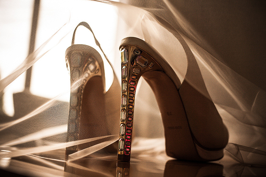Shoes covered with veil in warm, soft light at Washington DC wedding