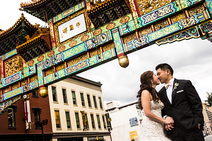 Bride and groom posing in Chinatown, Washington DC