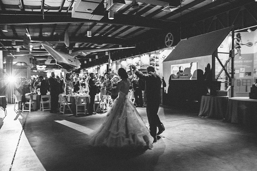 Bride and groom enter the reception area to greet guests at the Baltimore Museum of Industry