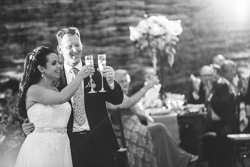 Bride and groom leading toast at AVAM Wedding