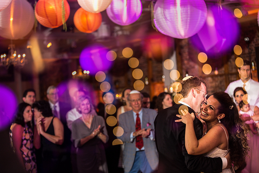 Bride and groom dancing in front of guests at their American Visionary Arts Museum wedding