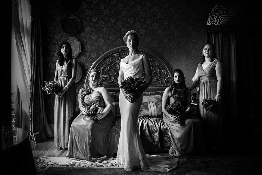 Bride and her bridal party posing at the Gramercy Mansion in Baltimore Maryland