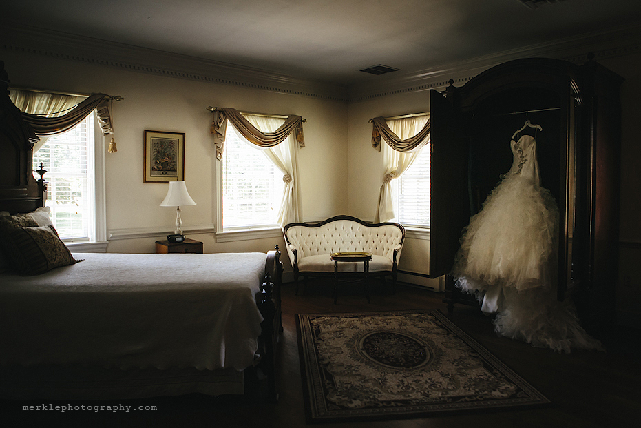 Wedding dress hanging in a armoire at Stone Manor