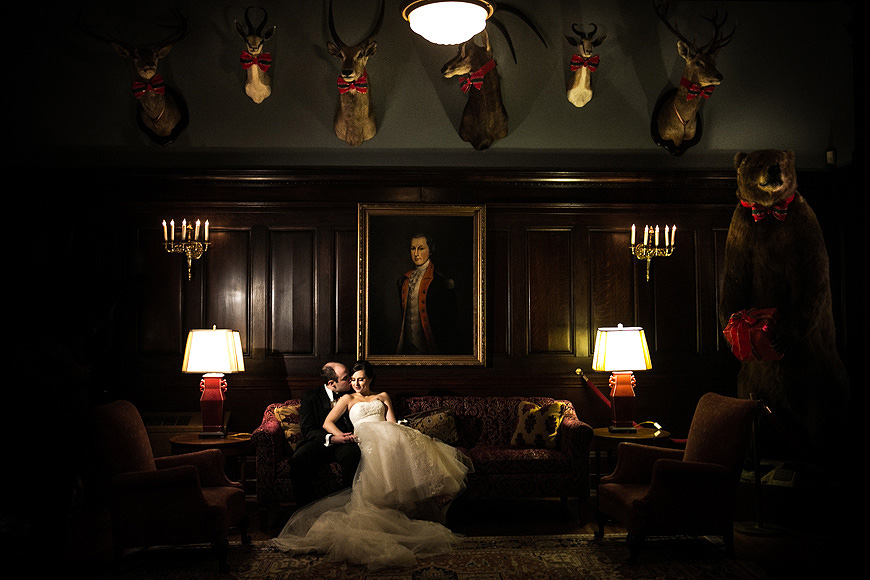 Bride and groom posing for a formal portrait at their wedding at the Maryland Club