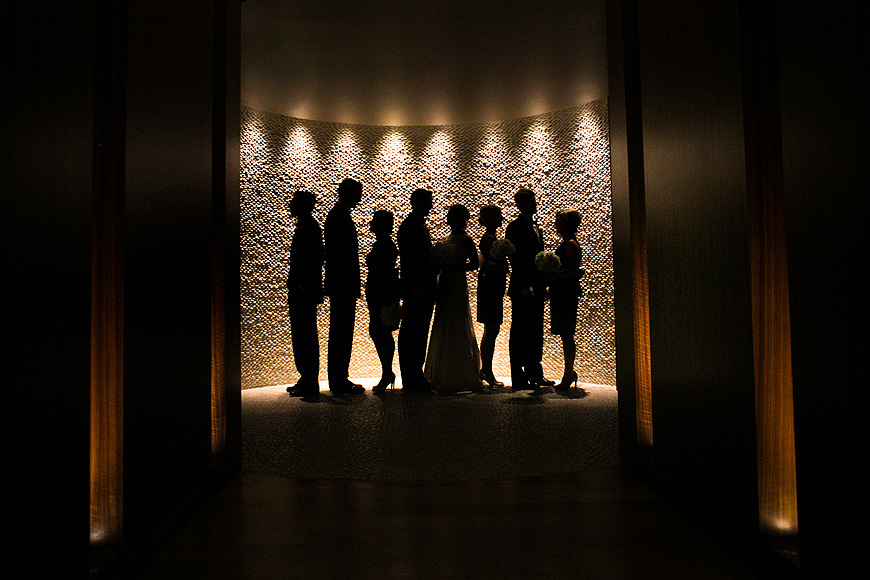 Bridal party sillhoueted in dramatic fashion at a Baltimore wedding at the Four Seasons