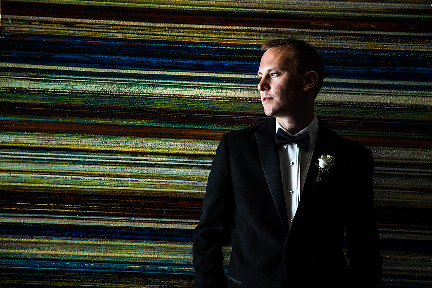 Groom in front of stripe patterned wall at a Four Seasons Baltimore wedding