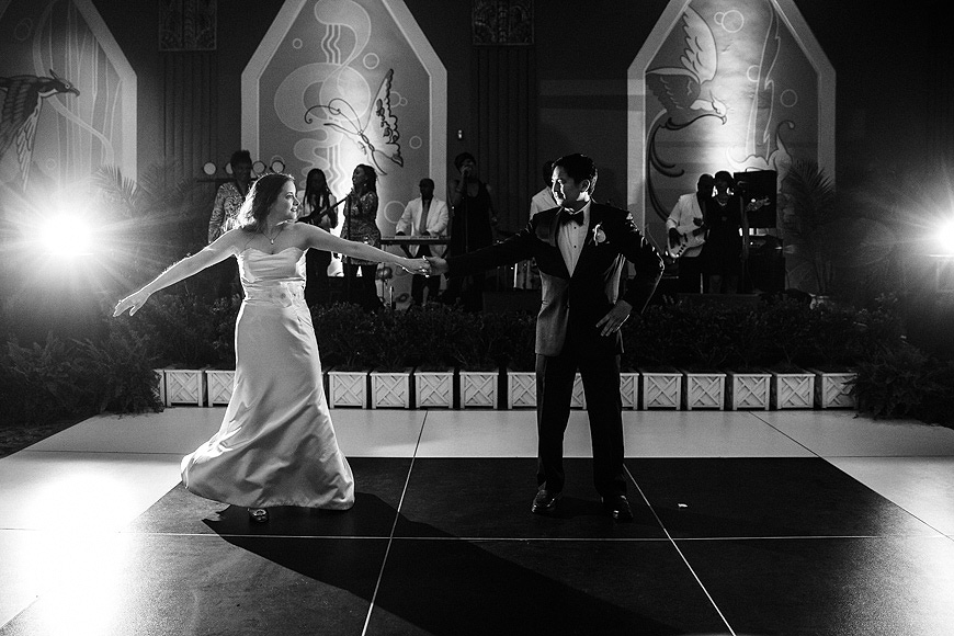 Bride and groom during their first dance in the historic Riviera Theater in Charleston SC