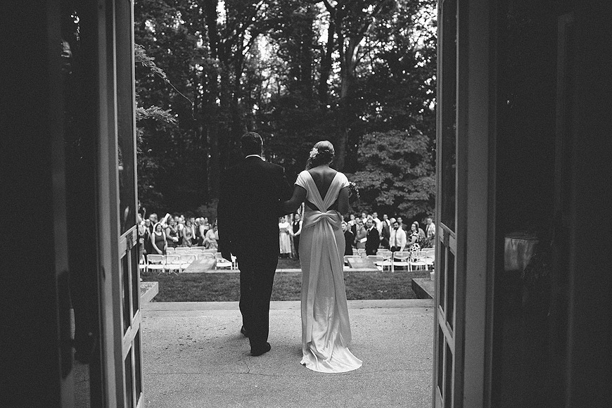 Bride walks with her father onto the grounds of the Liriodendron Mansion
