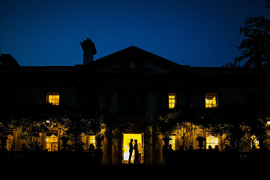 Bride and groom silhouetted at night at a Liriodendron Mansion wedding