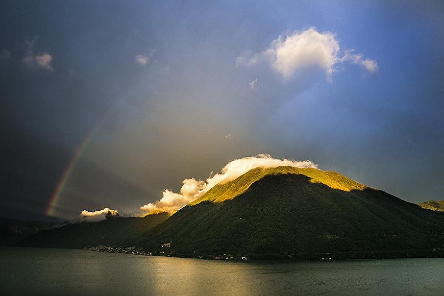 Rainbow over the mountains along Lake Como in Italy
