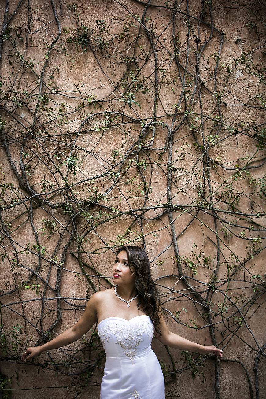 Bride in front of wall of vines in Lake Como Italy