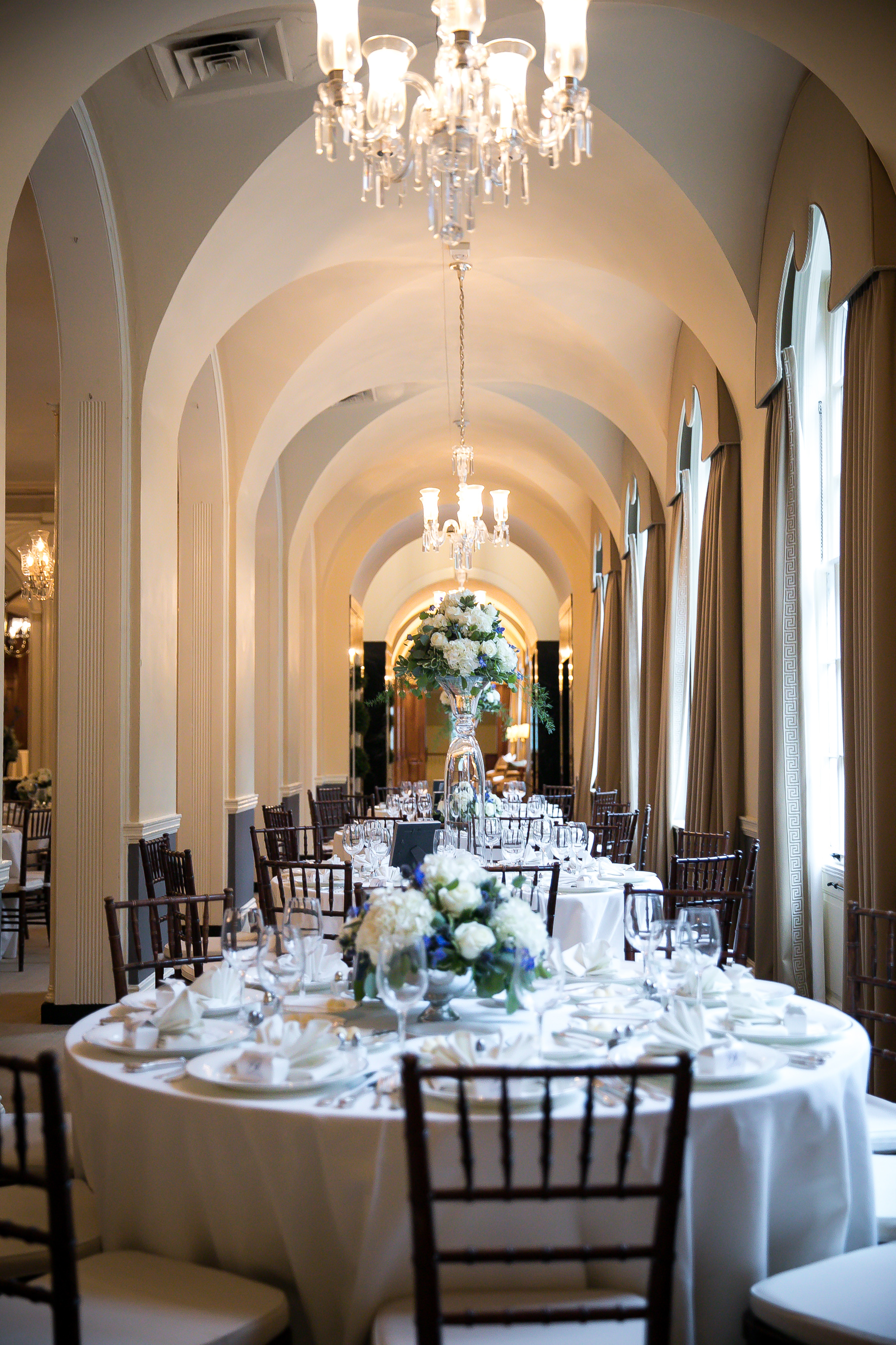 Table settings with white flower arrangements for wedding at the Baltimore Country Club