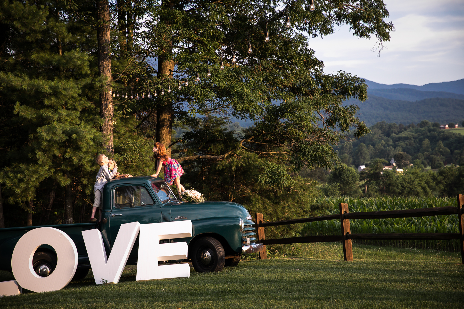 Wedding couple in old truck in field, Shenandoah Virginia
