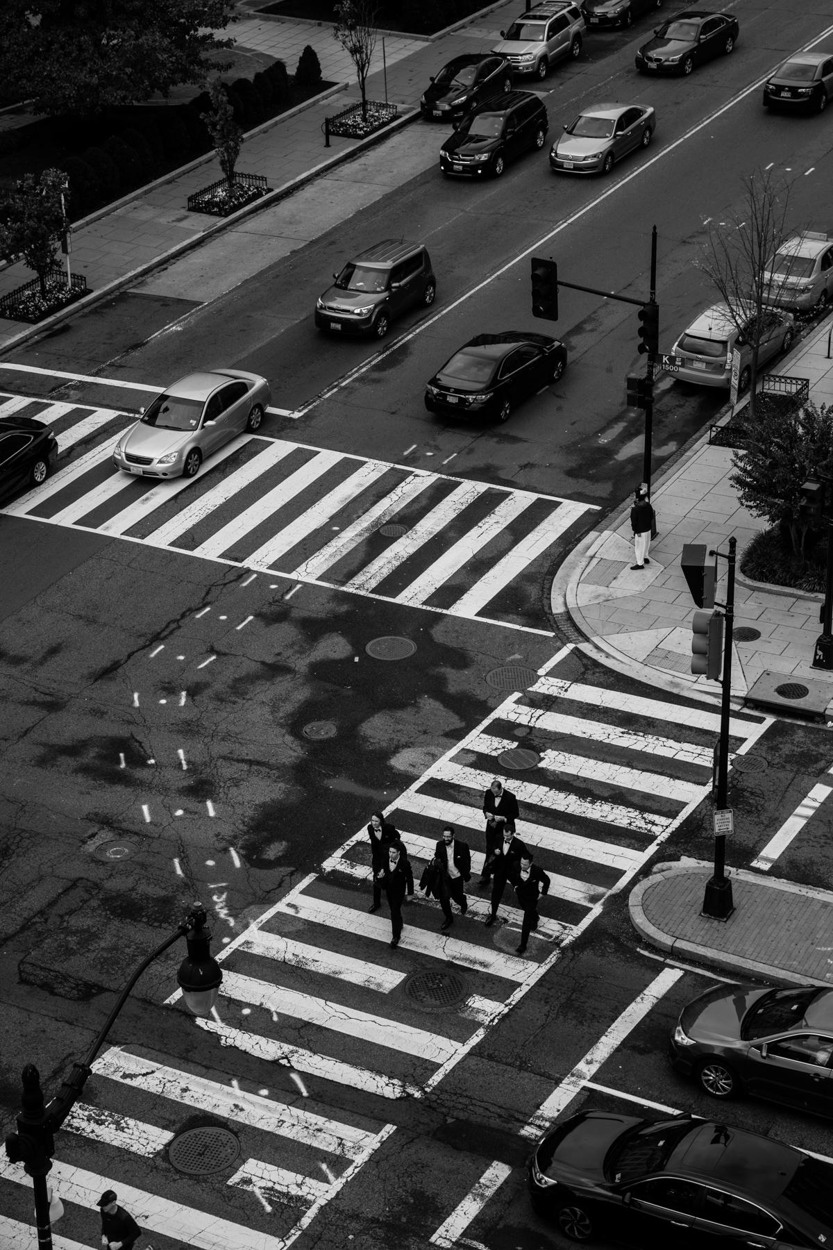 Groomsmen crossing an intersection in Washington DC