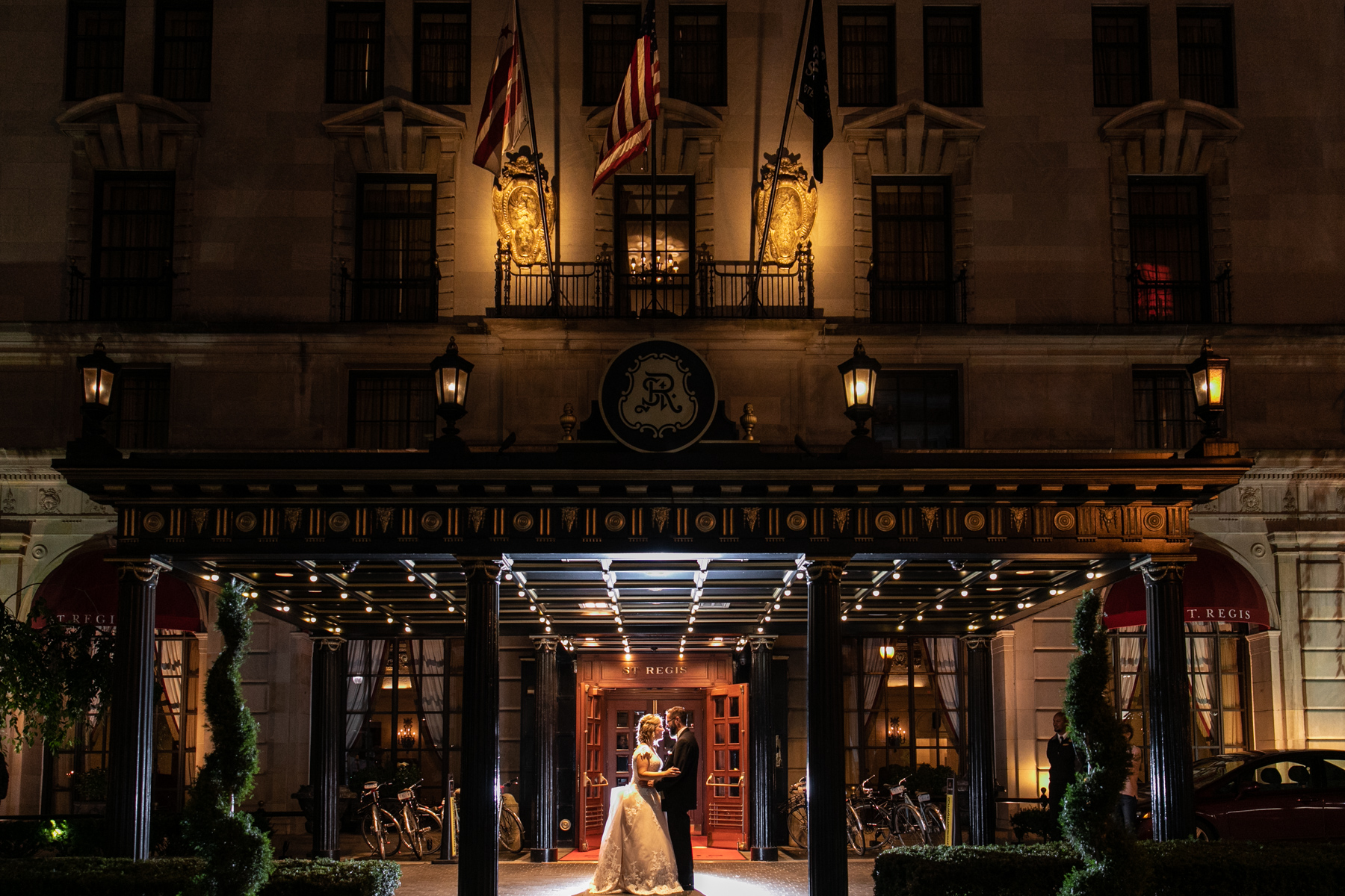 Wedding couple in front of the St. Regis Hotel Washington DC