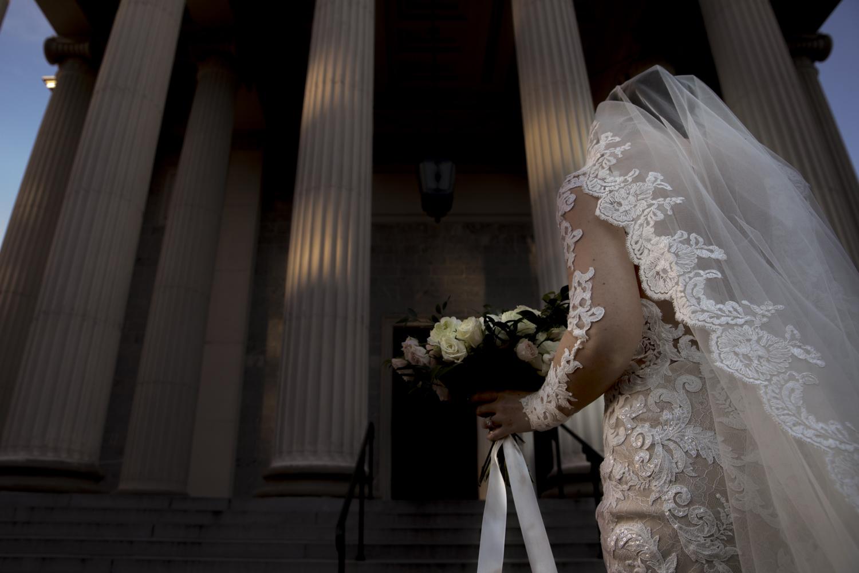 Bride entering the Baltimore Basilica for her wedding