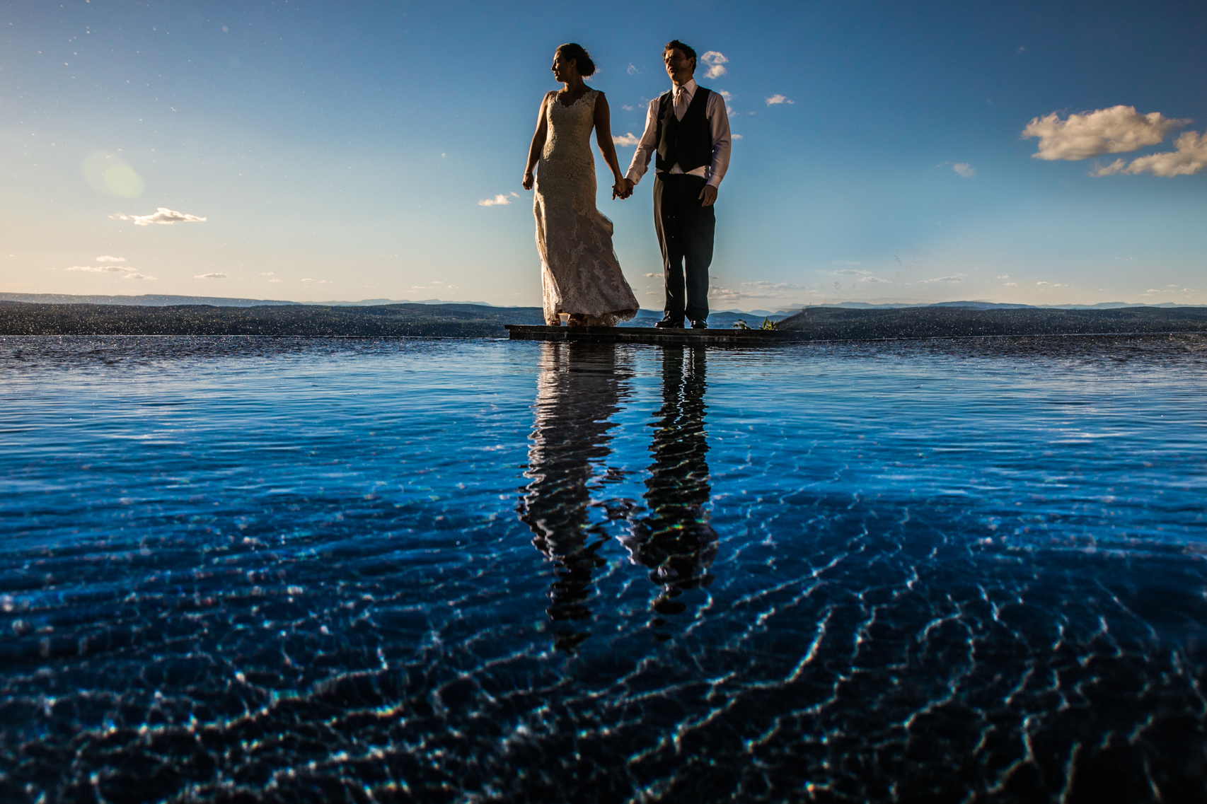 Couple reflecting in the water of a pool atop a mountain in Hudson Valley New York