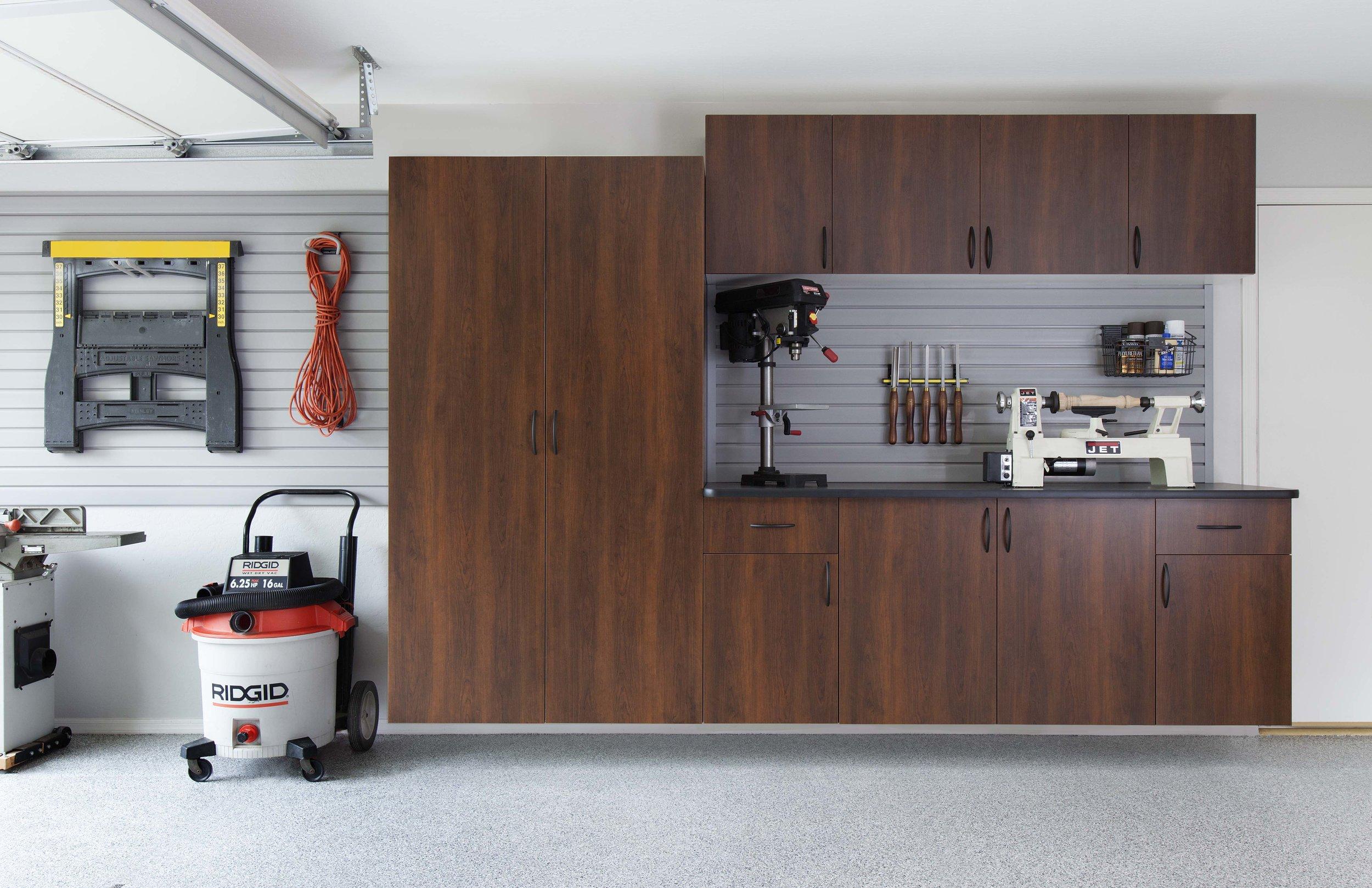 Coco Cabinets-Arch Pulls-Ebony Counter-Slatwall-Smoke Floor-Fetch-Sep 2013.jpg