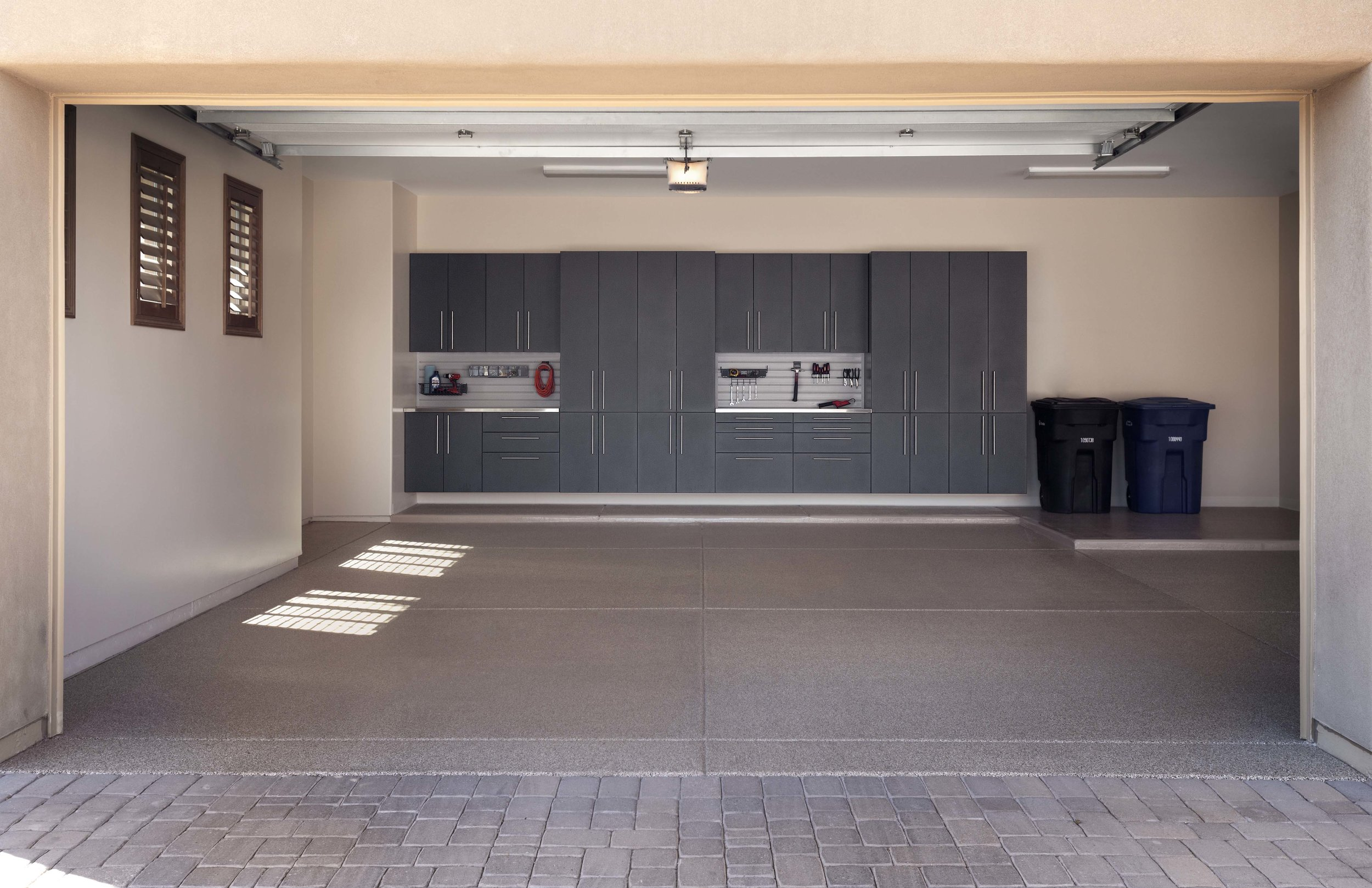 Granite Cabinets with Double Stainless Workbenh-Sedona 8th Flr-From Driveway-Feb 2013.jpg