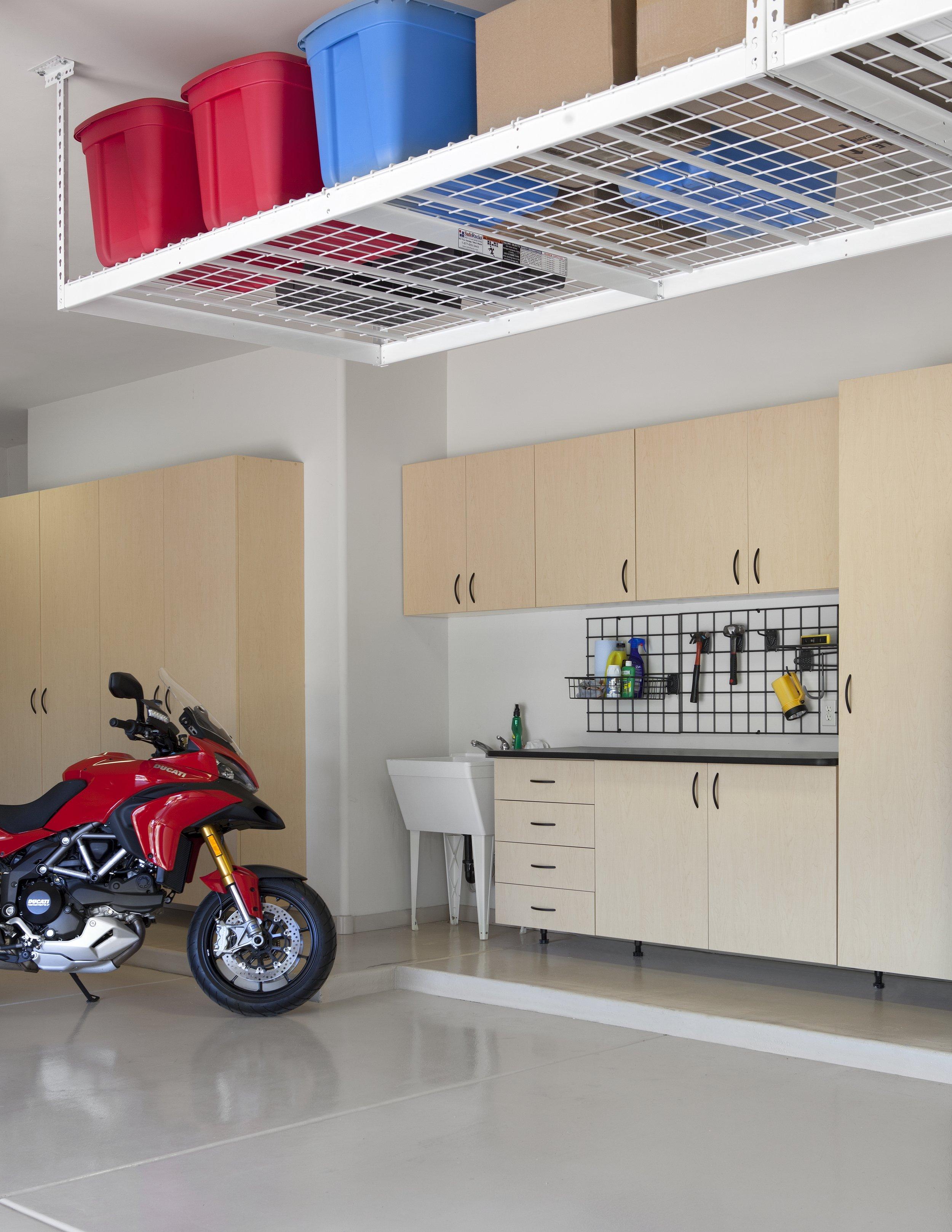 Maple Cabinets-Ebony Star Workbench-Overhead Storage-motorcycle-angle 2012.jpg