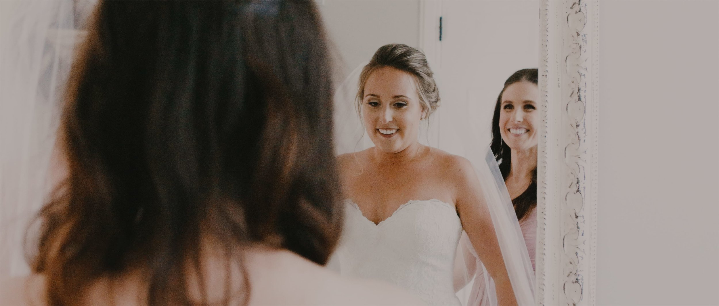 Bride Looks at Beautiful Dress in Mirror