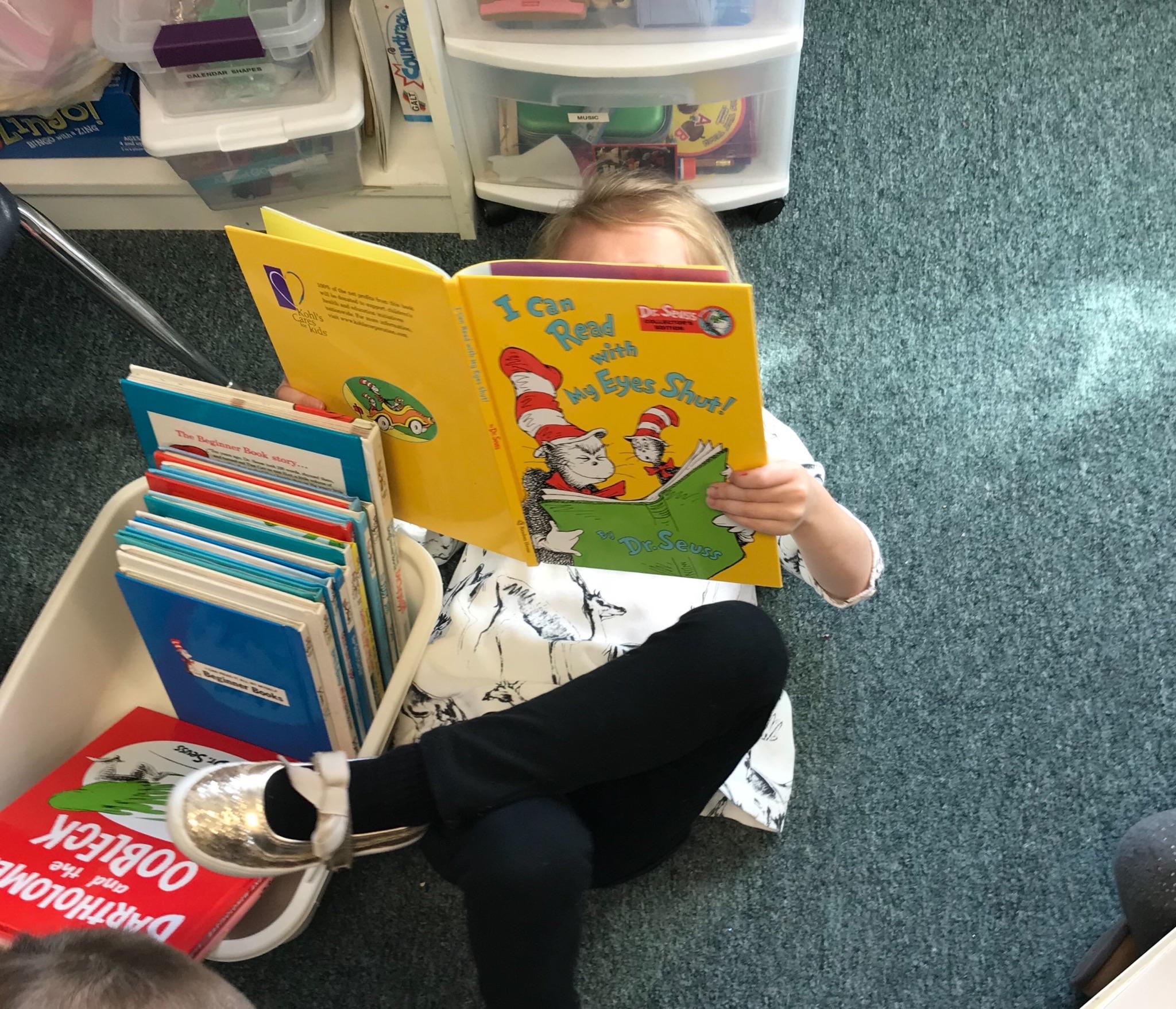 Mrs. Murray's Nursery School - Child Reading