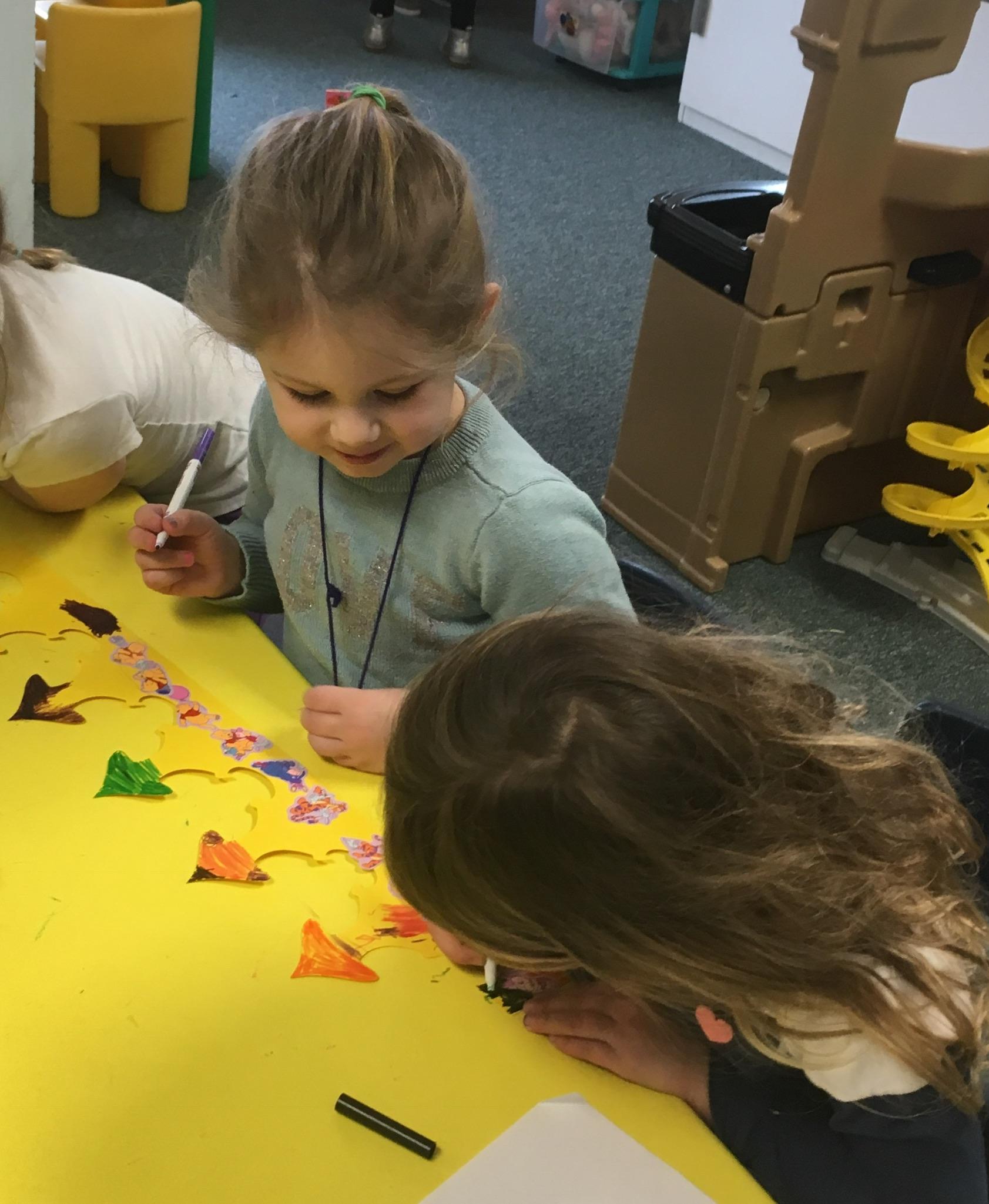 Mrs. Murray's Nursery School - Children working together