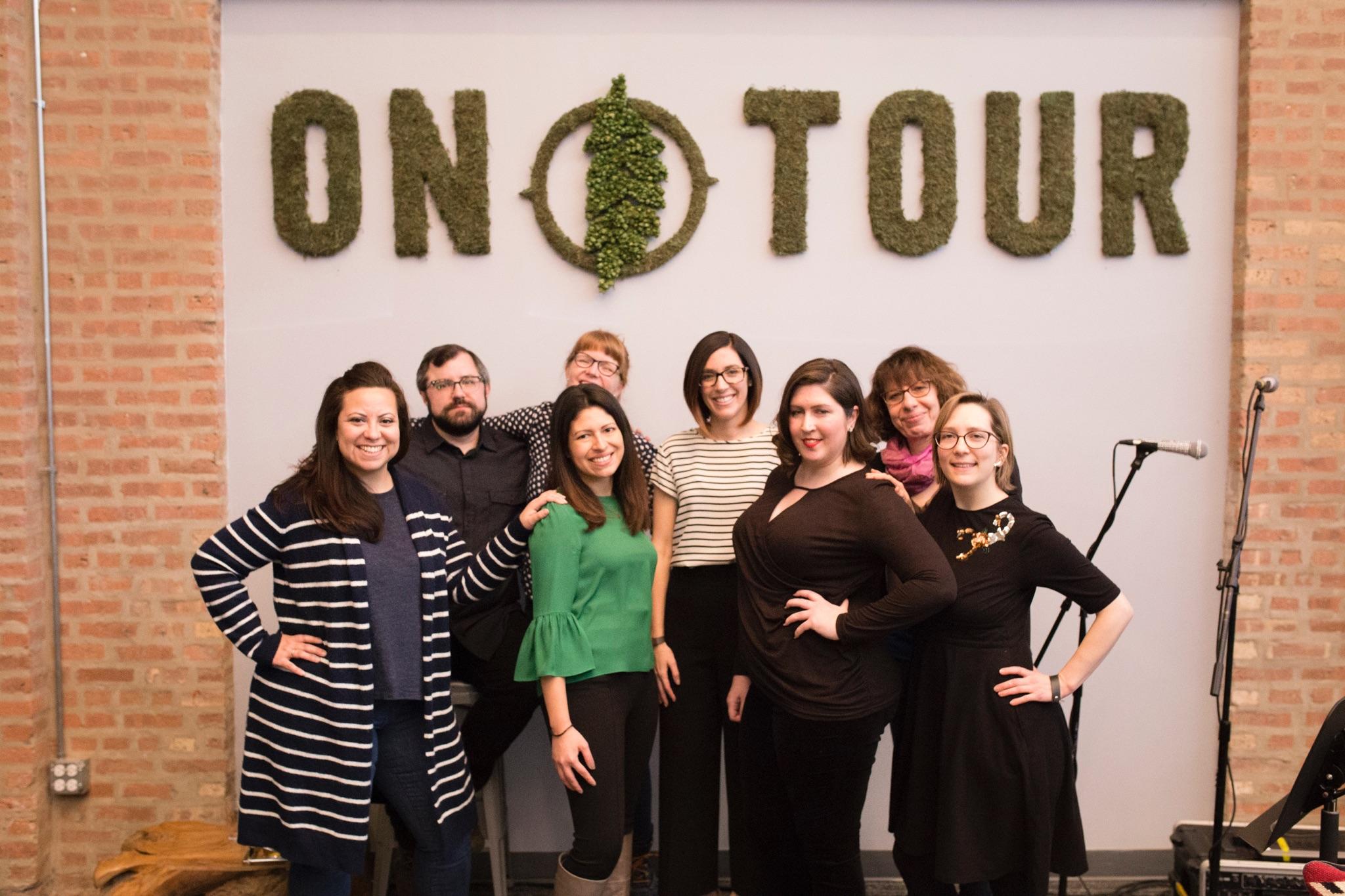 From left: Dee Fuentes (The host), Jason Fabeck, Megan Grandstaff, Jessica Perez, Brandi Morlen, Gina Waters, Sarah Michaelson, Christina Brandon (co-host and reader)  Photo credit: Wesley Fuentes