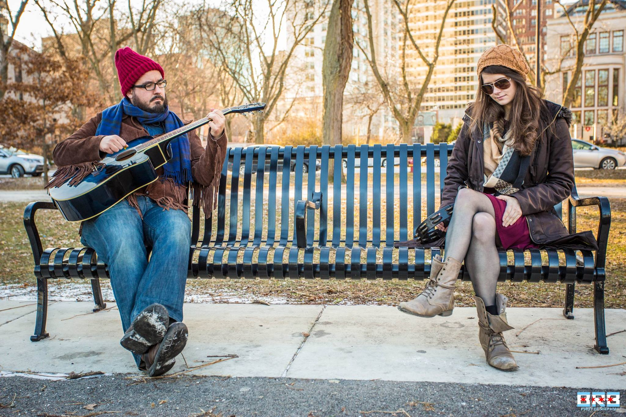 Tiny Shoulders - Tiny Shoulders is a folk duo based in Chicago, Il. and consists of Travis Cook (guitar, vocals) and Leigh Yenrick (vocals, percussion). They do not care for pigeons. They have big dreams, but such tiny shoulders.