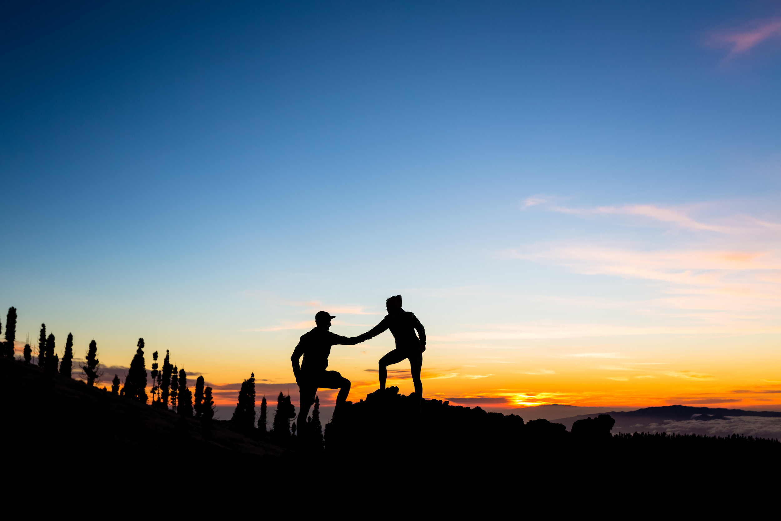 teamwork-couple-climbing-with-helping-hand-PL8FNGZ.jpg