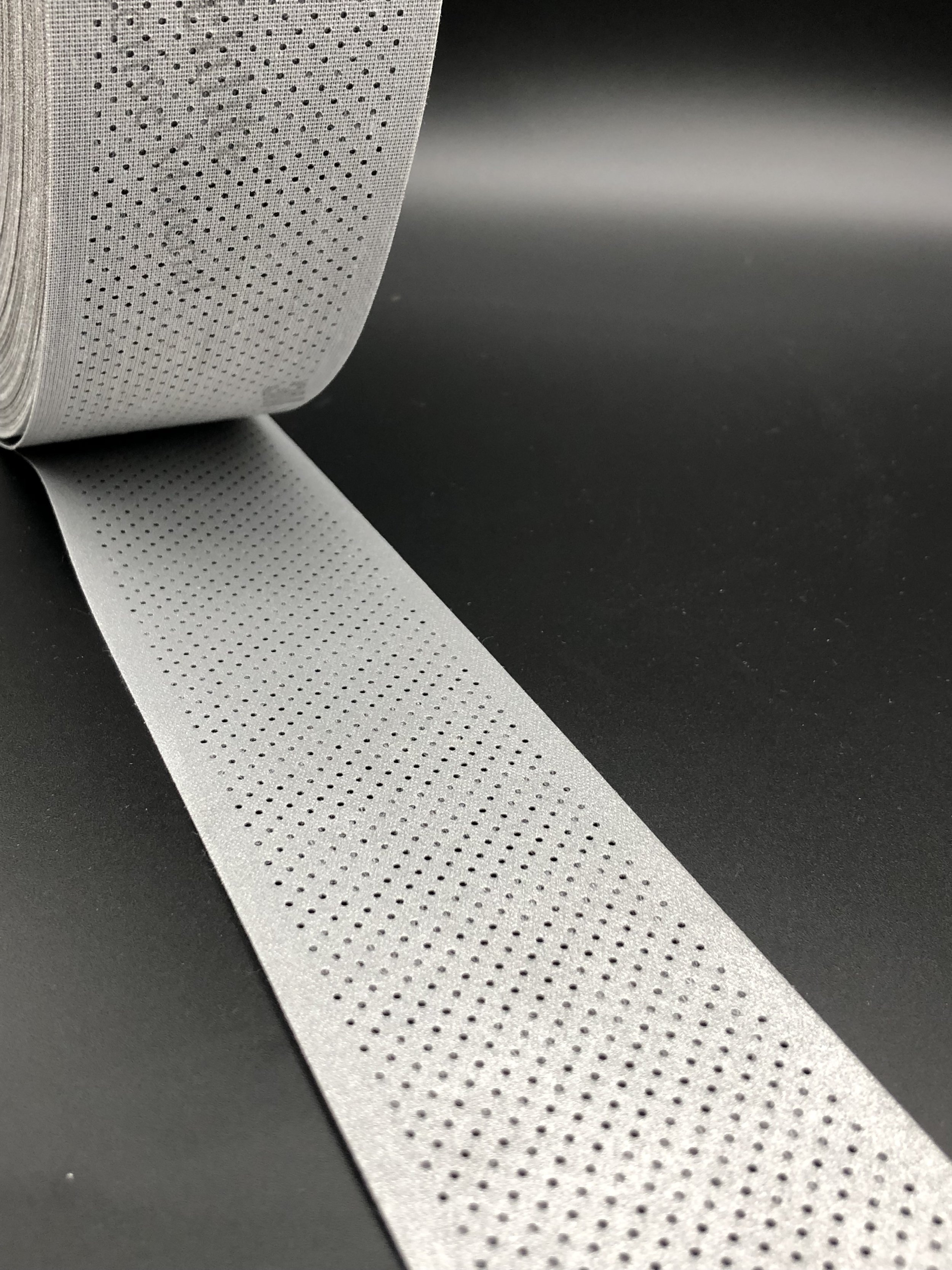 Perforated SS Series:  Our most popular patented series, which allows sewing space on both sides for easy sew on. The perforation is even throughout on both sides, and each hole is cut through for full breath-ability and ventilation