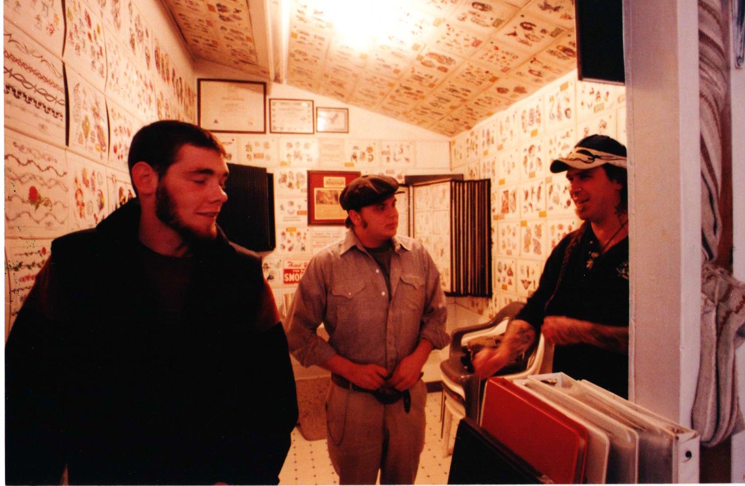 Inside Bozeman's Tattoos in the Alley, RJ Rosini's original MT shop. Old friends: Adam, Lunchbox, and Joker.