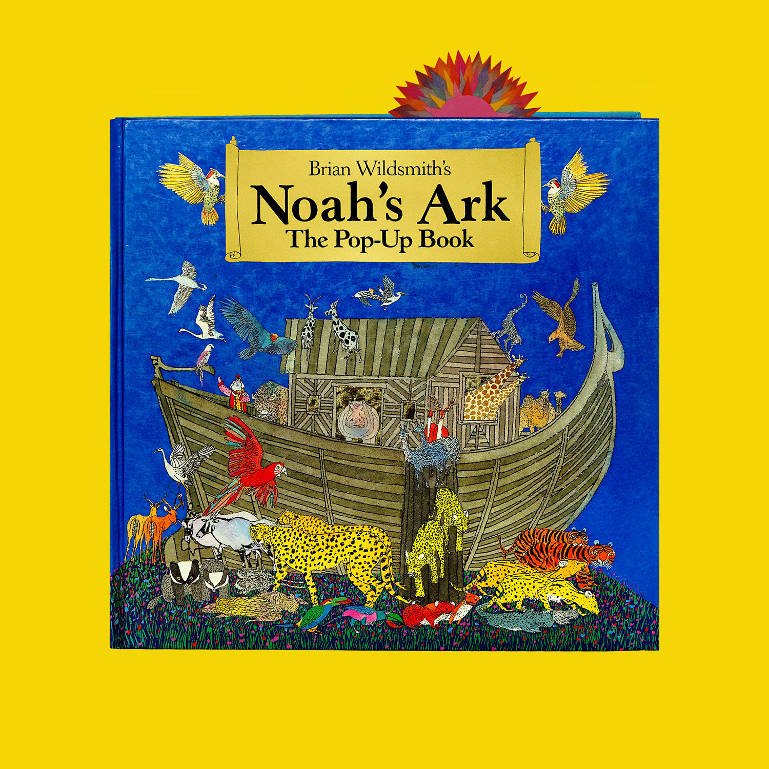 """NOAH'S ARK - 1994""""When an artist of Brian Wildsmith's eminence enters the world of pop-up something special is indicated, and so it is. While many of the effects must be credited to the paper engineer, Wildsmith has plenty of his own. In particular as ark and sea, dove and rainbow rise up from the page, they can be viewed as rewardingly from the back as the front and the utilitarian tabs which operate some of the gadgetry are in themselves small works of art. Each of the five pop-up spreads has its surprise. Pelican and elephant help to load the ark. Noah's family act as a welcoming party as the animals enter. Lightening flashes across a stormy sky. A typical Wildsmith's sun breaks through the clouds as the dove returns. Sun and rainbow join in benediction over Ararat. Pop-up collectors will want this one…""""Junior Bookshelf"""