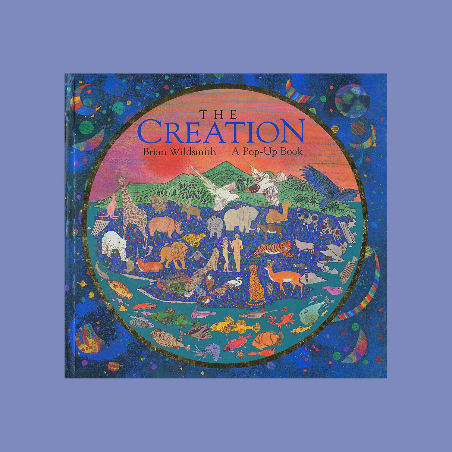 """THE CREATION - 1995""""Five interactive 3-D spreads depict the creation story from the book of Genesis. Man and woman, plants and trees, the creatures of the sea and air, all gods handiwork fill this full colour, vibrant, book.""""""""...delicious illustrations and beautifully designed, awe-inspiring pop-ups...Wildsmith captures the wonder and poetry of the creation story in a book that families will treasure.""""Times Educational Supplement"""