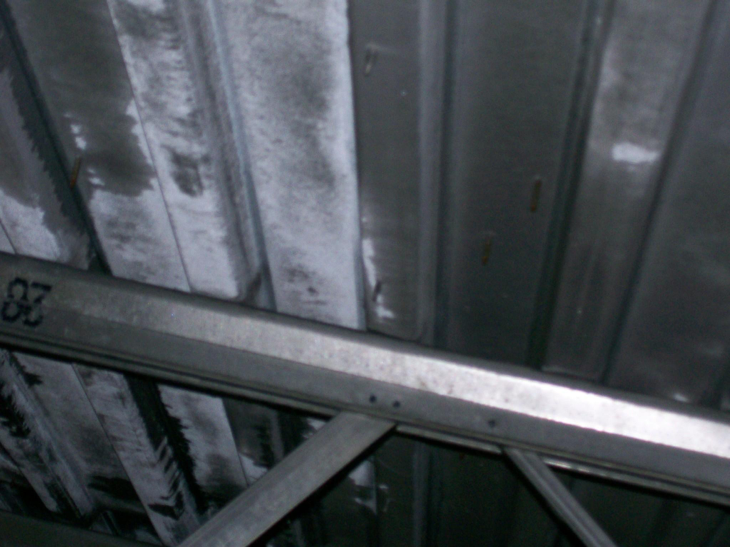 Figure 2a:    Frost forming on underside of metal roof deck in above-ceiling space.