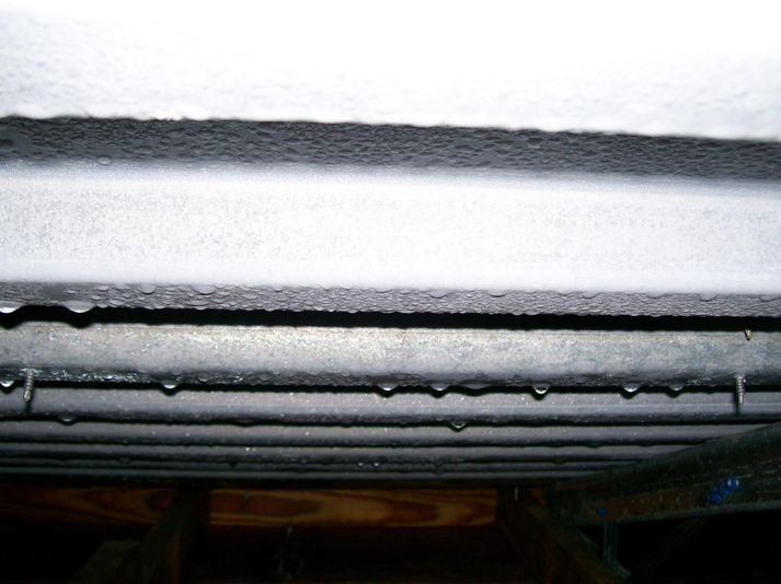 Figure 2b:    Melting frost/ice dripping off underside of metal roof deck in above-ceiling space.