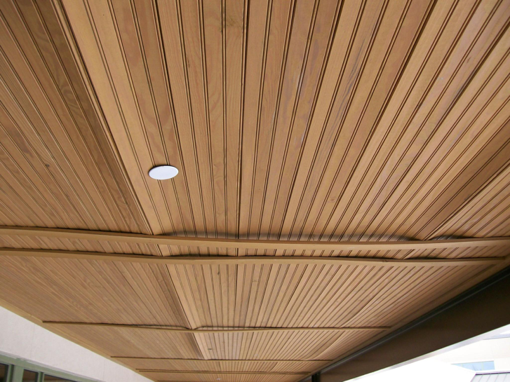 Figure 3a:    Warping and damage to wood bead board ceiling in porch areas attributed to water from melting frost/ice in above-ceiling space.